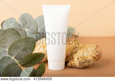 Blank Cosmetics Tube On The Beige Isometric Background.natural Stones,fresh Eucalyptus Branch In Fro