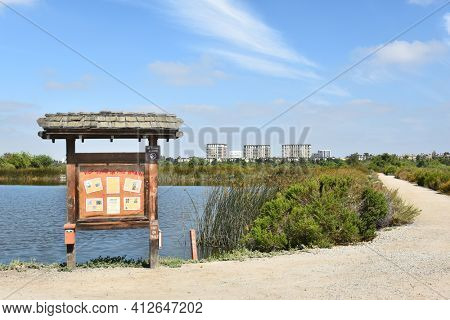 IRVINE, CA - JULY 9,2016: Information Kiosk on Fledgling Loop Trail at Pond B in the San Joaquin MArsh Reserve. Wildlife information and maps of the Reserve are available.