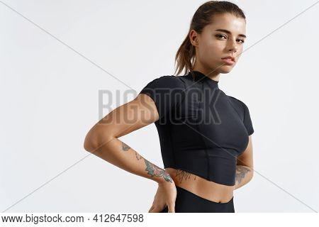 Fitness Woman Looking Confident At Camera With Hands On Hips, Exercising And Workout On White Backgr