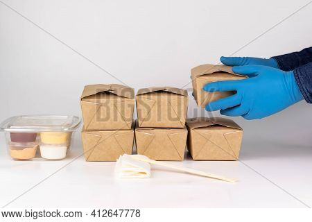 Food Delivery Service During Lockdown And Coronavirus Concept. Courier Hands In Medical Gloves Eco P