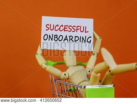 Successful Onboarding Symbol. White Paper. Words 'successful Onboarding'. Wooden Model Of A Human In