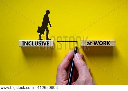 Inclusive At Work Symbol. Wooden Blocks With Words 'inclusive At Work' On Beautiful Yellow Backgroun