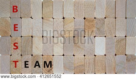 Best Team Symbol. Woden Blocks With Words 'best Team'. Beautiful Wooden Background. Business And Bes