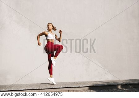 Fitness Woman Doing Cardio Interval Training Outdoors. Caucasian Female In Sportswear Exercising Out