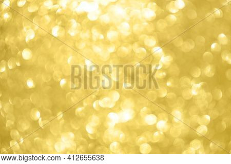 Abstract Shiny Glitter Christmas Or New Year Background. Light Gold Glitter Background With Sparklin