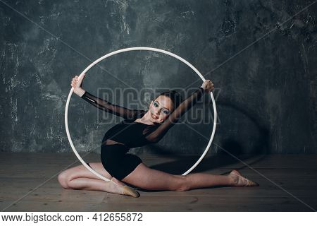 Young Girl Professional Gymnast Woman Dance Rhythmic Gymnastics With Hoop At Studio