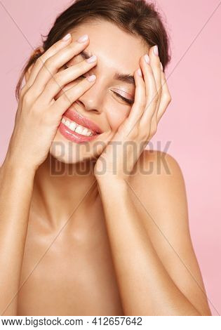 Beauty. Young Woman With Natural Makeup, Naked Body, Smiling And Touching Clean Gentle Skin, Enjoy W