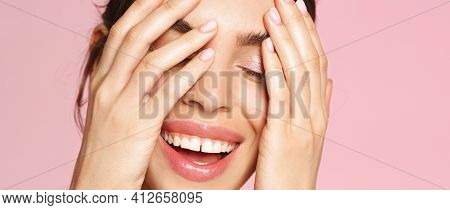 Skincare Routine. Close Up Face Of Beautiful Woman Smiling And Touching Healthy Well-nourished Skin,