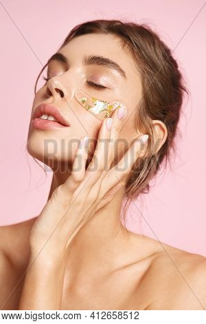 Skincare. Romantic Woman Apply Under Eye Patches With Active Botanic Ingredients Chamomile, Reduce D