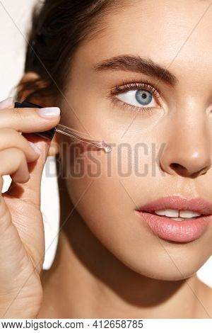 Beauty And Skincare Concept. Female Model Using Natural Moisturizer With Active Natural Ingredients,
