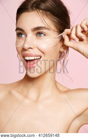 Smiling Woman Take-off Under Eye Collagen Patches, Nourish Gentle Skin With Gel Pads On Clean Skin,