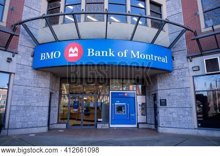 March 15,2021 Port Coquitlam British Columbia Canada Front Entrance To Bank Of Montreal