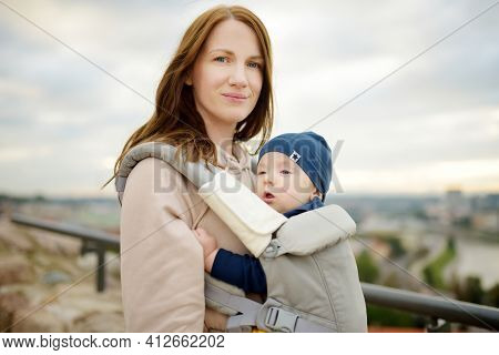 Young Mother Holding Her Baby Son While Enjoying A View Of Vilnius City From The Gediminas Hill. Exp