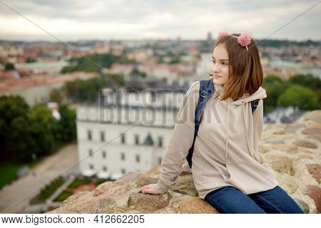Cute Teenage Girl Enjoying A View Of Vilnius City From The Gediminas Hill. Exploring Tourist Attract