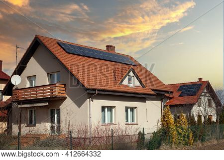 Solar Panels Roof Of A Modern House - Photovoltaic On A Home Roof.