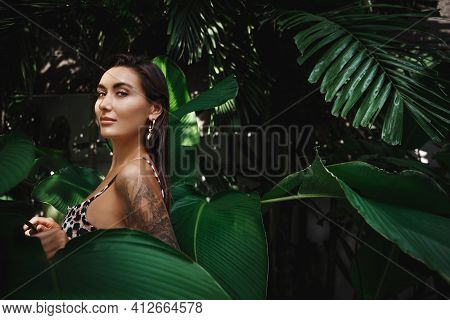 Sexy Brunette Woman In Bikini Walking In Jungles With Tropical Palm Trees, Wearing Beach Bikini And
