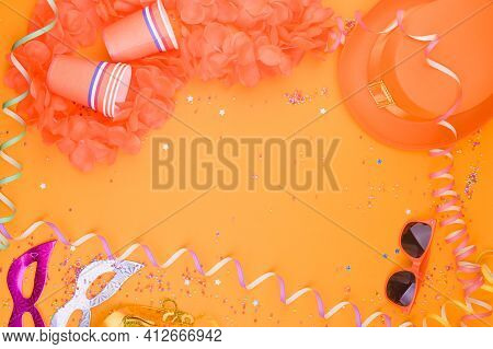 Decor For A Traditional Celebration Of Kings Day In The Netherlands. Orange Hat, Glasses, Jewelry An