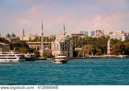 Istanbul, Turkey - 09 07 2020: View On The Bank Of Bosporus Strait With Touristic Boat Departing Fro