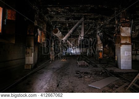 Burnt Interior Of Industrial Building Or Warehouse. Consequences Of Fire