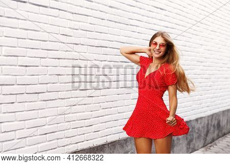 Beautiful Blonde Woman Walking Down The Road With Happy Face, Jumping From Excitement, Enjoying Summ