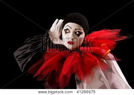Mime Pierrot actor holding her hands as in listening