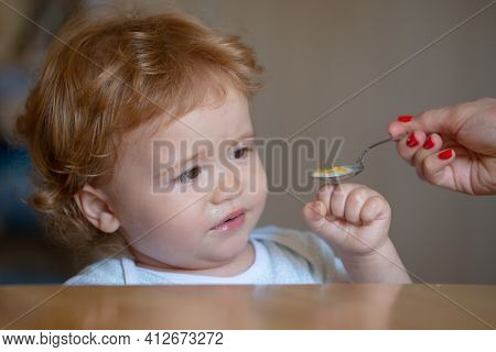 Feeding Baby. Not Hungry. Kid Refusing To Eat. Child Have No Appetite. Upset Little Kid Refuse To Ea