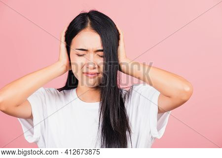 Asian Portrait Beautiful Cute Young Woman Have Closed Ears With Hand Palms And Close Eyes, Studio Sh