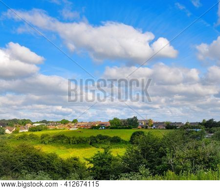 Beautiful bright colorful summer landscape with fantastic clouds in the background