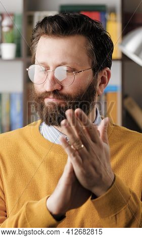 Man Sarcastic Applause. Vertical Video Of Gloomy Skeptical Bearded Man In Glasses In Office Or Apart