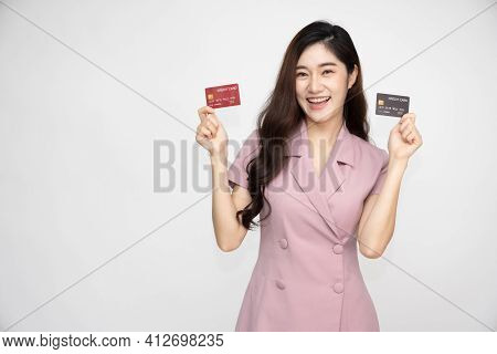 Young Beautiful Asian Woman Smiling, Showing, Presenting Credit Card For Making Payment Or Paying On
