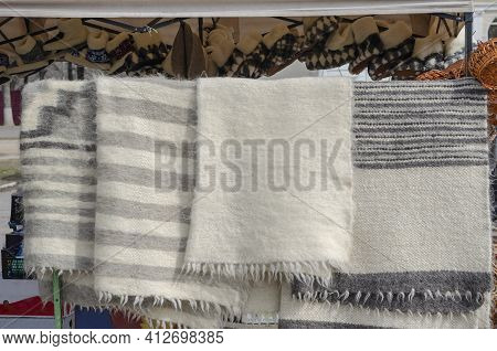 Trade In Natural Wool Products On The Local Market. Traditional Ukrainian Striped Blanket And Room S
