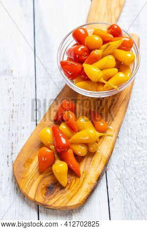 Pickled red and yellow hot chili peppers