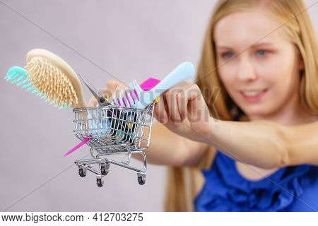 Girl With Hair Accessories In Shopping Cart