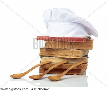 Chef's Hat And Vintage Cookbooks Isolated On A White Background.