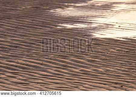 Beautiful Wavy Sand Texture. Sand Dunes, Rippled Sand Formations. Summer Sand Background Texture.