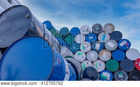 Old Chemical Barrels. Big Stack Of Blue Oil Drum Against Sky. Steel Oil Tank. Toxic Waste Warehouse.