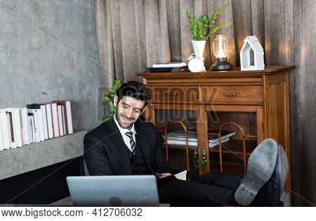 Business Man Successful Relaxing Or Sleeping After Finished Work Put Feet On The Desk. Ceo Worker Lo