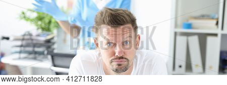 Man In Medical Office At Proctologist Closeup