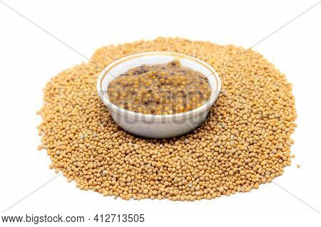 Traditional Dijon Mustard Sauce In A Bowl With Mustard Seeds. Isolated On White Background