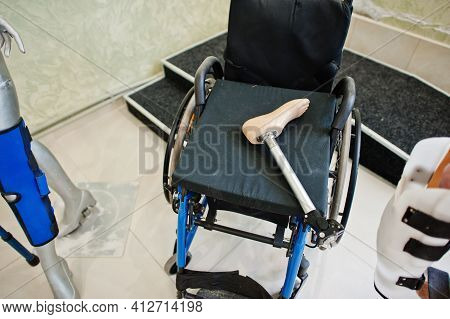 Wheelchair And Mannequin At Prosthetist Clinic. Health Care.