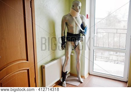 Mannequin With Cast On Arm And Neck At Prosthetist Clinic.