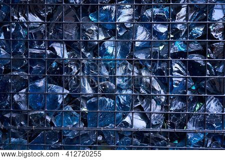 Blue Crystal Mineral Stone. Gems. Artificial Crystals In Stone Cage Modern Construction Wall Backgro