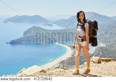 Woman Hiking Lycian Way With Backpack. Fethiye, Oludeniz. Beautiful View Of The Sea And The Beach. H