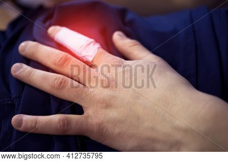 White Plaster On A Young Womans Injured Finger. Volleyball Injury. Sports Injurie. Hurting Finger