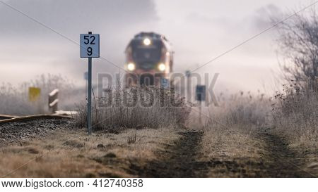 KOLOBRZEG, WEST POMERANIAN - POLAND - 2021: Foggy morning over the region and the railroad track with the regional train going