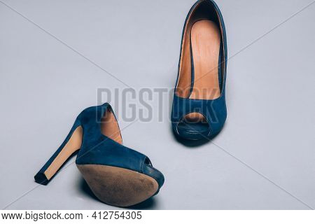 Blue Worn Shoes High Heels On Gray Background