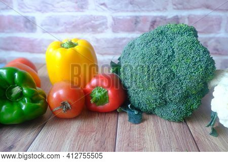 Healthy Food With Paper, Brocoli Cauliflower On Wooden Background..