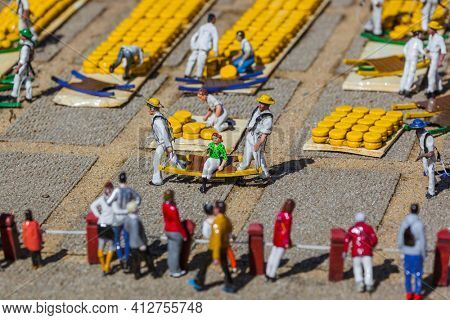 The Hague, Netherlands - April 26, 2017: Alkmaar cheese market in Madurodam miniature park in The Hague.
