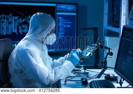 Microelectronics Engineer Works In A Modern Scientific Laboratory On Computing Systems And Microproc