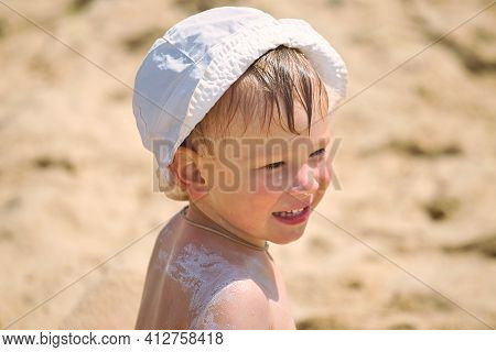 Portrait Of A Child On The Beach After Swimming